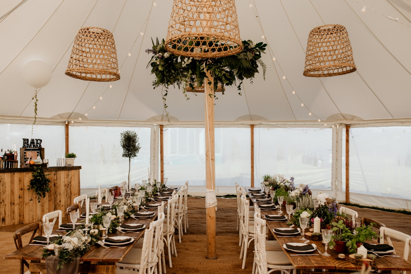 A marquee wedding set up in rustic style